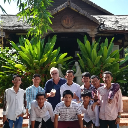 The boys from the Student Hostel pose in front of the church, with Agustin.